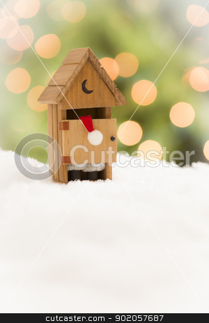 Santa in An Outhouse on Snow Over and Abstract Background stock photo, Santa in A Miniature Outhouse on Snow Over and Abstract Background. by Andy Dean