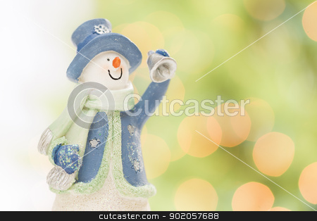 Snowman Statue On Snow Over a Blurry Abstract Background stock photo, Snowman Statue On Snow Over a Blurry Abstract Green and Gold Background. by Andy Dean
