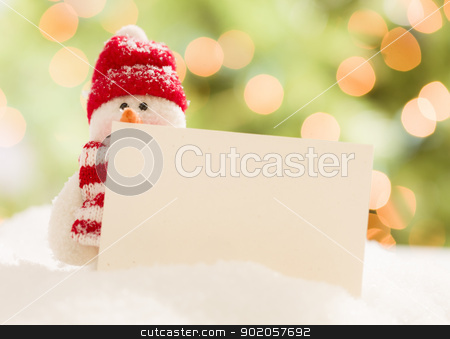 Cute Snowman with Blank White Card Over Abstract Background stock photo, Cute Snowman with Scarf and Hat Next To Blank White Card Over Abstract Background by Andy Dean