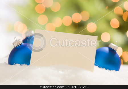Blue Christmas Ornaments Behind Blank Off-white Card stock photo, Blue Christmas Ornaments Behind Blank Off-white Card Ready for Your Own Text.  by Andy Dean