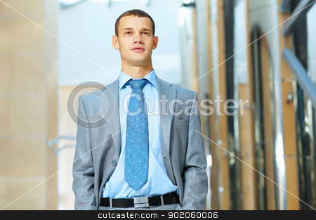 portrait of happy smiling young businesman stock photo, Portrait of happy smiling young businessman, standing in office by Sergey Nivens
