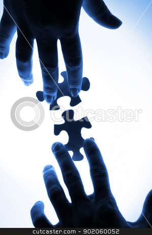 Puzzle pieces stock photo, puzzle piece coming down into its place by Sergey Nivens