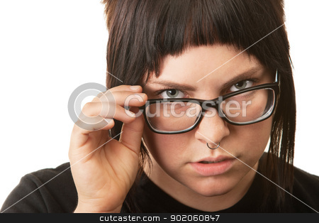 Serious Female Teenager stock photo, Serious female teenager looking over her eyeglasses by Scott Griessel