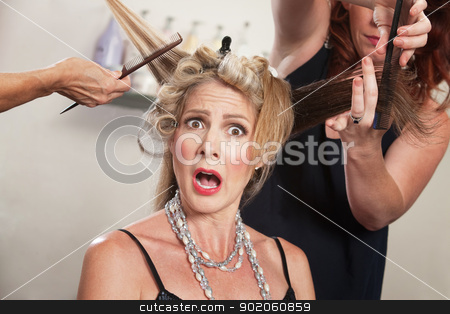 Surprised Woman in Hair Salon stock photo, Hair stylists working around surprised blond woman by Scott Griessel