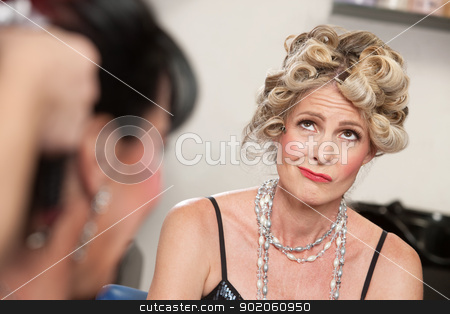 Frowning Lady in Salon stock photo, Frowning European woman with friend in hair salon by Scott Griessel