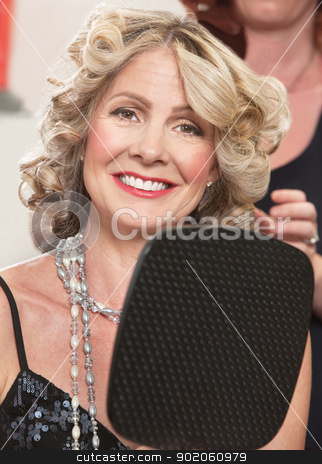 Pretty Lady in Beauty Salon stock photo, Attractive middle aged female with mirror in hair salon by Scott Griessel