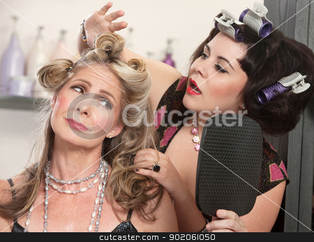 Friend Fixing Bad Hairdo stock photo, Woman in curlers fixing a woman's bad hairdo by Scott Griessel