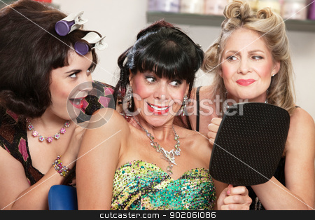 Lady and Friends Happy with Haircut stock photo, Grinning woman and friends with mirror in hair salon by Scott Griessel