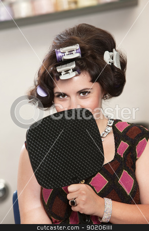 Woman in Curlers Behind Mirror stock photo, Insecure young white female in curlers behind mirror by Scott Griessel