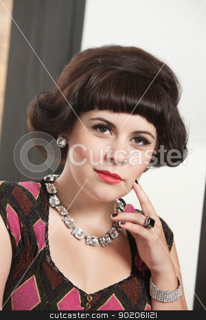 Woman with Finger on Cheek stock photo, Serious young Caucasian woman with finger on cheek by Scott Griessel