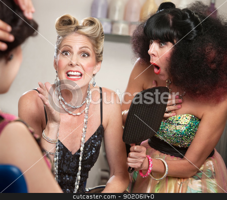 Excited Woman in Hair Salon stock photo, Excited woman with friends in hair salon gesturing by Scott Griessel