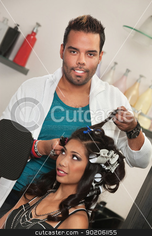 Stylist Removes Hair Curlers stock photo, Handsome hair stylist removing woman's hair curlers by Scott Griessel