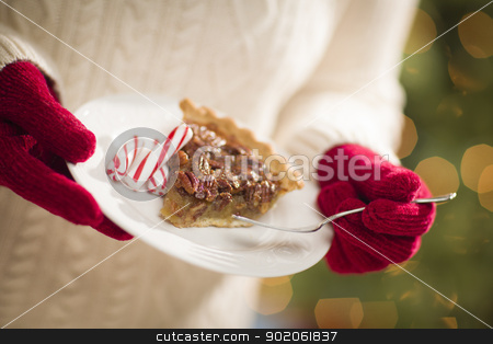 Woman Wearing Red Mittens Holding Plate of Pecan Pie, Peppermint stock photo, Woman Wearing A Sweater and Seasonal Red Mittens Holding A Plate of Pecan Pie with Peppermint Sticks. by Andy Dean