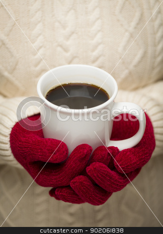 Woman in Sweater with Red Mittens Holding Cup of Coffee stock photo, Woman in Sweater with Seasonal Red Mittens Holding a Warm Cup of Coffee. by Andy Dean