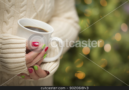 Woman with Red and Green Nail Polish Holding Cup of Coffee stock photo, Woman in Sweater with Seasonal Red and Green Nail Polish Holding a Warm Cup of Coffee. by Andy Dean