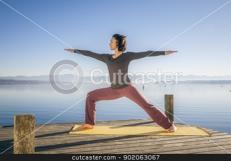 yoga woman stock photo, An image of a pretty woman doing yoga at the lake by Markus Gann