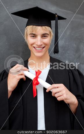 Portrait of teen Guy Celebrating Graduation stock photo, Portrait of teen Guy Celebrating Graduation in the class by Wavebreak Media
