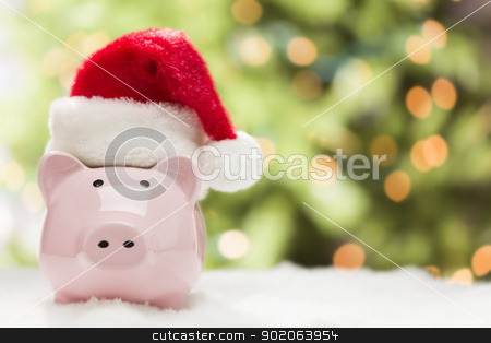 Pink Piggy Bank with Santa Hat on Snowflakes stock photo, Pink Piggy Bank Wearing Red and White Santa Hat on Snowflakes with Abstract Green and Golden Background - Room for Your Own Text. by Andy Dean