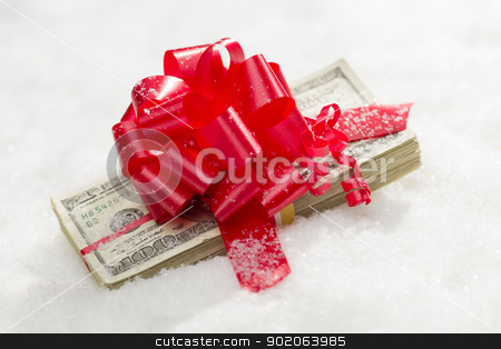 Stack of Hundred Dollar Bills with Red Ribbon on Snow stock photo, Stack of One Hundred Dollar Bills with Red Ribbon on Snow Flakes. by Andy Dean