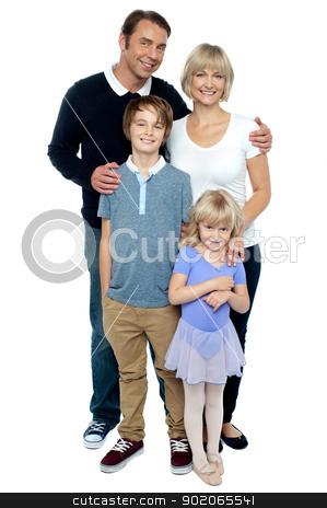Indoor studio shot of lovely family, four members stock photo, Indoor studio shot of lovely family, four members. Photogenic family by Ishay Botbol