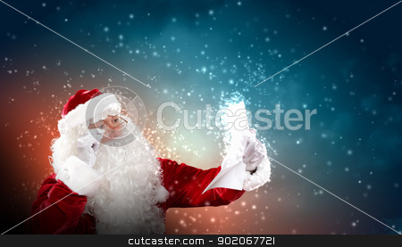 Santa with christmas letter stock photo, Santa holding Christmas letters and looking at camera by Sergey Nivens