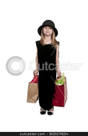 Girl Shopping Bags stock photo, Beautiful litte girl on a shopping spree by Robert Byron