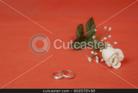 Valentine's day stock photo, Two silver rings with rose in red background by Mola Kaliva