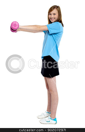 Pretty teen working out with pink dumbbells stock photo, Pretty teen working out with pink dumbbells. Standing sideways, isolated against white. by Ishay Botbol
