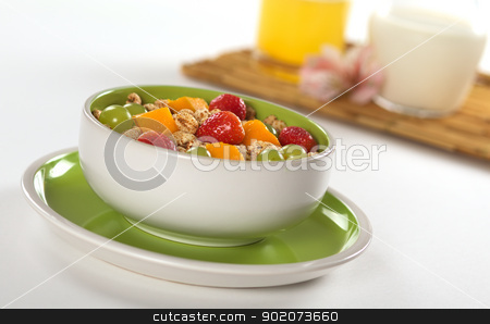 Fruit Salad with Cereals stock photo, Fresh and healthy breakfast: Fruit salad out of mango, strawberry and white grape with puffed wheat cereal and orange juice and milk in the background (Selective Focus, Focus on the middle of the bowl)  by Ildi Papp