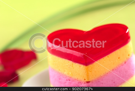 Peruvian Jelly Cake stock photo, Colorful Peruvian heart-shaped jelly-pudding cake called Torta Helada (Very Shallow Depth of Field, Focus on the tip of the cake) by Ildi Papp