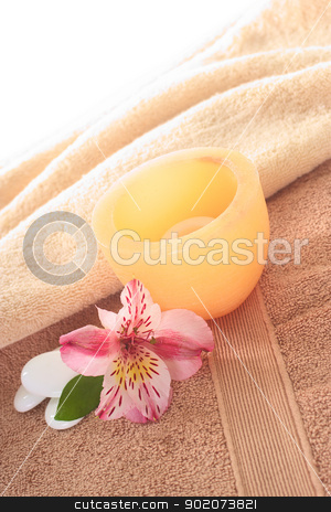 Spa Still Life stock photo, Spa still life with Inca Lily and candle on towel (Selective Focus, Focus on the front of the candle and the flower) by Ildi Papp