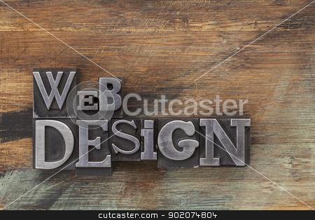 web design in metal type blocks stock photo, web design - text in vintage letterpress metal type blocks on a grunge painted wood by Marek Uliasz