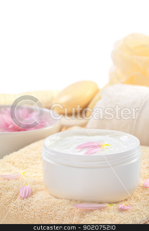 Soft Cream stock photo, Soft body, hand and face cream with pink petals on top in a bathroom/spa setting (Selective Focus, Focus on the horizontal/back petal on the cream) by Ildi Papp