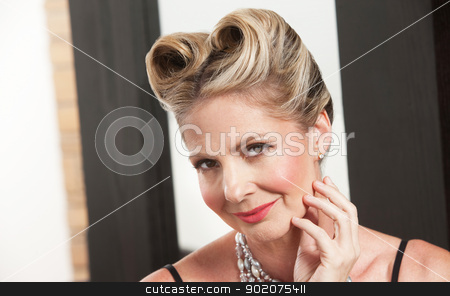 Gorgeous Woman stock photo, One gorgeous Caucasian female with stylish hairdo by Scott Griessel
