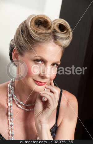 Elegant Woman stock photo, Elegant middle aged blond female with hand on chin by Scott Griessel