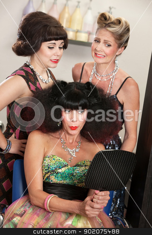 Lady Proud of Bad Hairdo stock photo, Bad hairdo on happy woman and embarrassed friends in salon by Scott Griessel