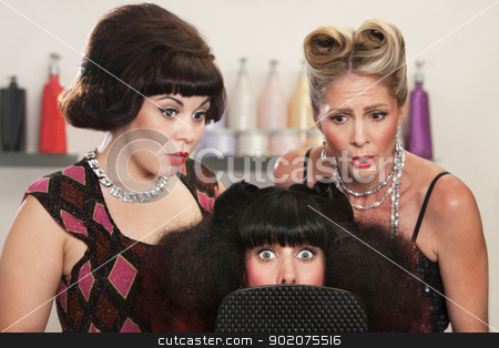 Shocked Lady in Hair Salon stock photo, Wide eyed woman behind mirror with two friends in hair salon by Scott Griessel