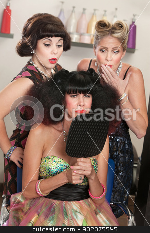 Sulky Lady in Hair Salon stock photo, Pouting woman in afro wig with embarrassed friends in hair salon by Scott Griessel