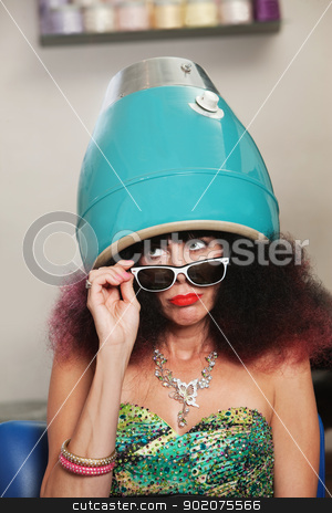 Pouting While Under Hair Dryer stock photo, Pouting lady with frizzy hair sitting under hair dryer by Scott Griessel