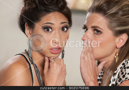 Two Ladies Telling Secrets stock photo, Concerned young woman listening to someone whispering secrets by Scott Griessel