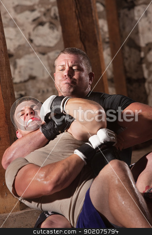 Man Trapped in Choke stock photo, European man stuck in choke hold during MMA fight by Scott Griessel