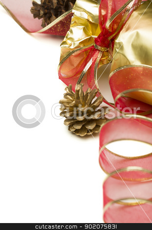 Christmas Present with Red Ribbon and Pine Cones on White stock photo, Christmas Present with Ribbon and Pine Cones on a White Background. by Andy Dean