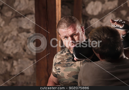 Mixed Martial Artists Sparring stock photo, Mature MMA fighter throws jab at opponent by Scott Griessel