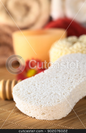 Spa Still Life stock photo, Spa still life with sponge and candle, towels in the back (Selective Focus, Focus on the front of the sponge) by Ildi Papp