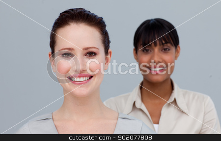 Portrait of a smiling caucasian and an Afro-American businesswom stock photo, Portrait of a caucasian and an Afro-American businesswomen smiling at the camera by Wavebreak Media