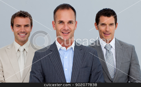 Portrait of smiling businessmen with folded arms stock photo, Portrait of smiling three businessmen with folded arms by Wavebreak Media