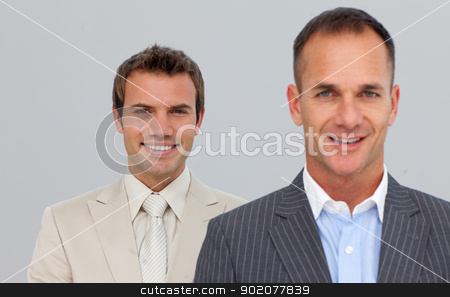 Portrait of smiling businessmen with folded arms stock photo, Portrait of smiling two businessmen with folded arms by Wavebreak Media