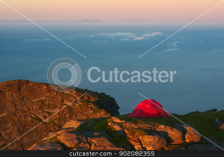 Tent on the Reinebringen on the Lofoten, Norway stock photo, Tent on the mountain ridge above Reine on Moskenesoya, Lofoten, Norway lit by the midnight sun and looking onto the sea and the mainland of Norway by Ildi Papp