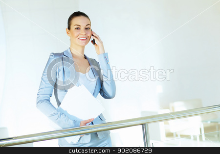 portrait of a confident young businesswoman stock photo, Portrait of happy smiling young businesswoman in office by Sergey Nivens