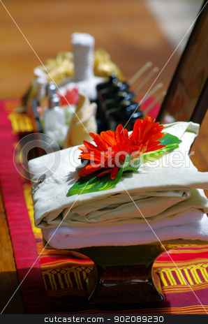 Spa setting  stock photo, Spa setting with towel and oil by Vitaliy Pakhnyushchyy